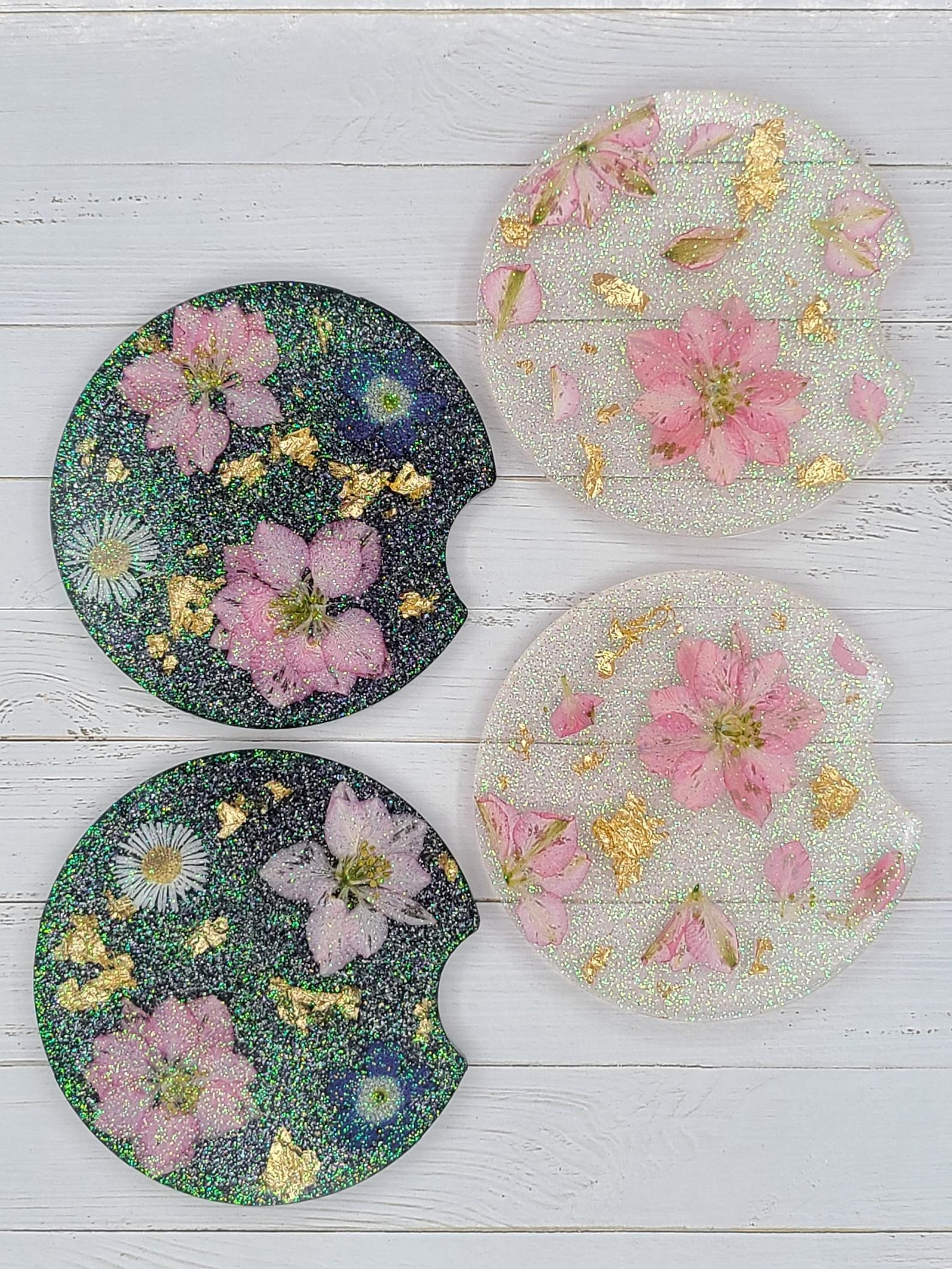 the four coasters with flowers and sparkles