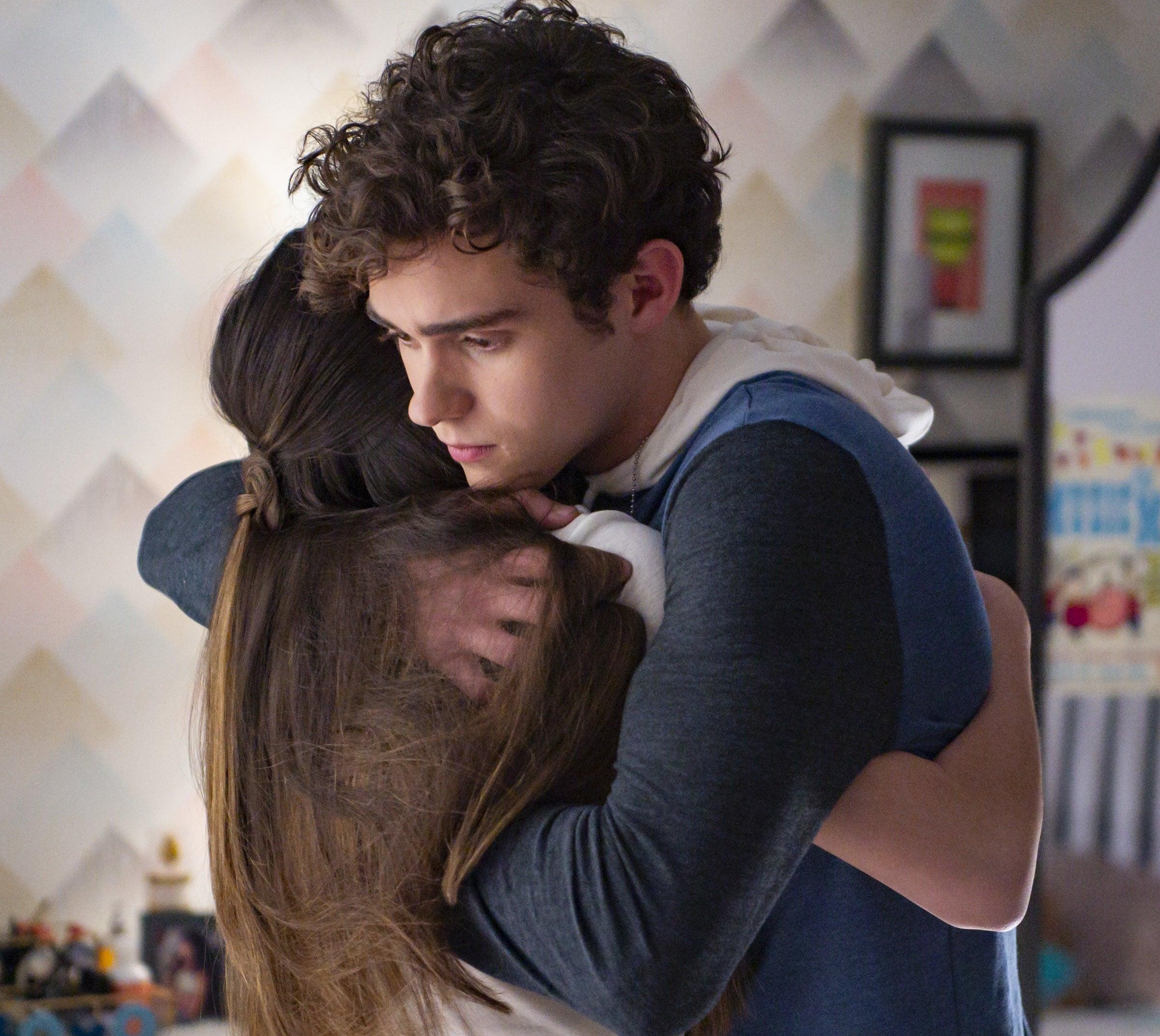 Nini and Ricky hugging