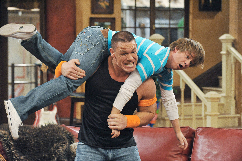 John Cena lifting Jackson over his shoulders