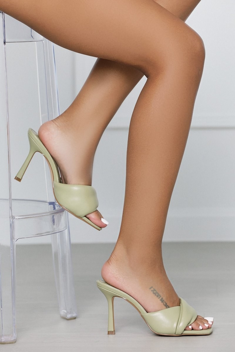 model in the high-heel sage green mules