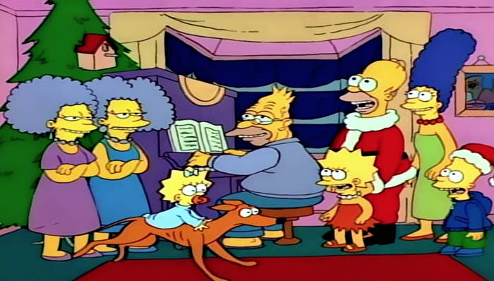 The entire Simpson family singing Christmas carols as Grandpa plays the piano and Maggie rides Santa's Little Helper