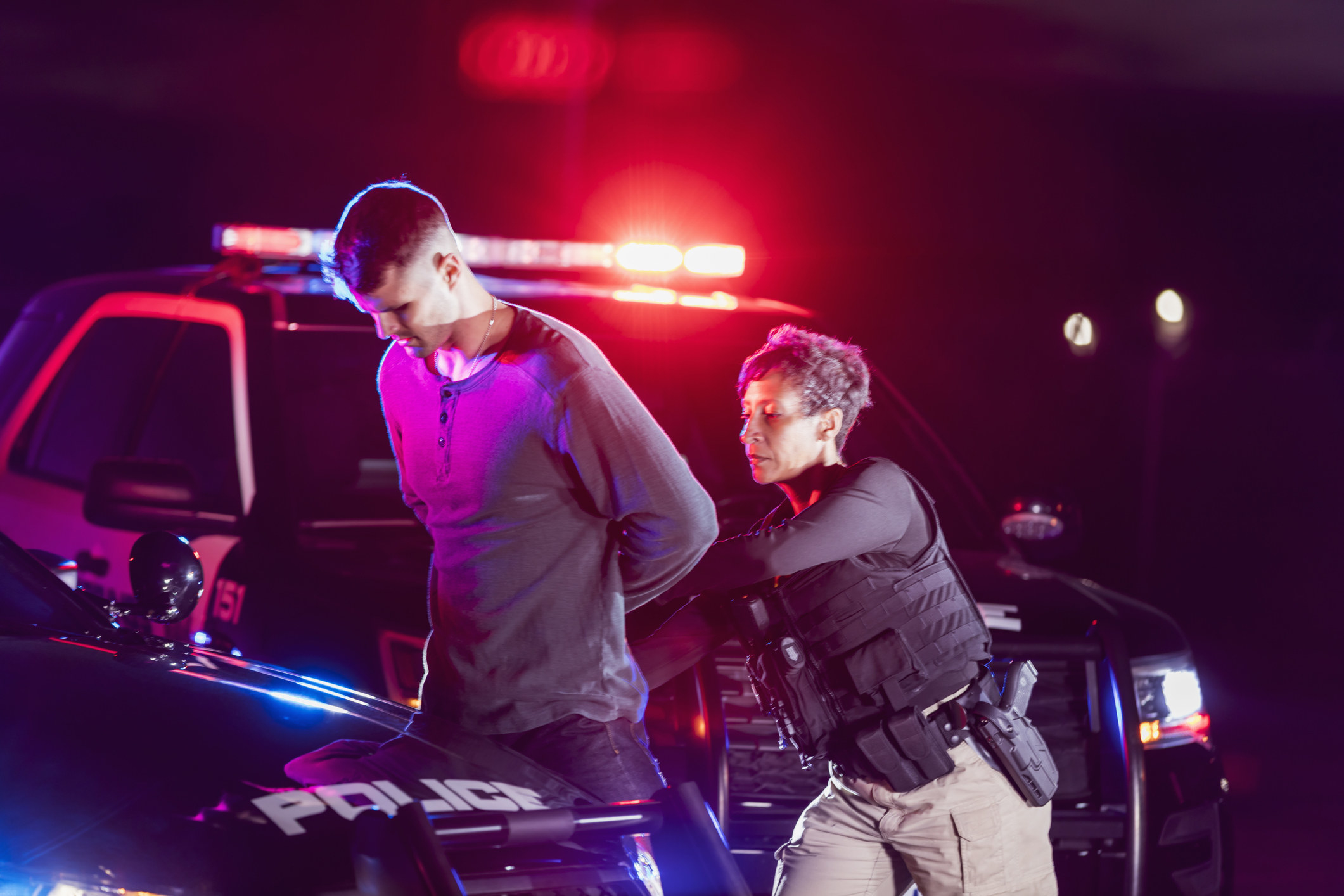 Police officer arresting a young man