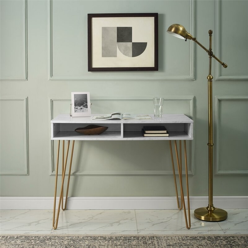 faux white marble desk with gold metal hairpin legs