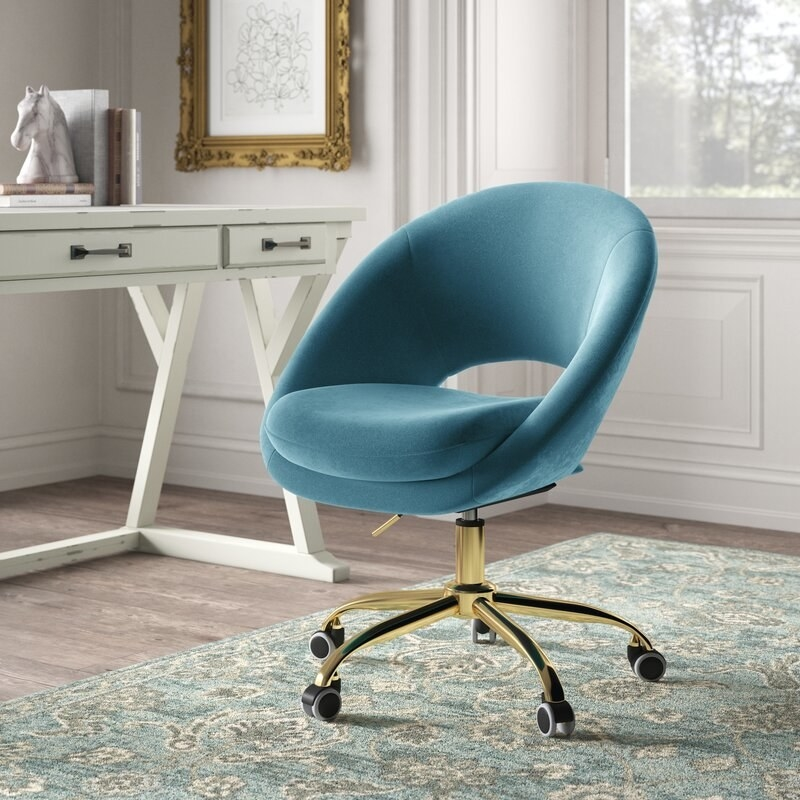 blue rounded office chair with open back, gold legs, and wheels