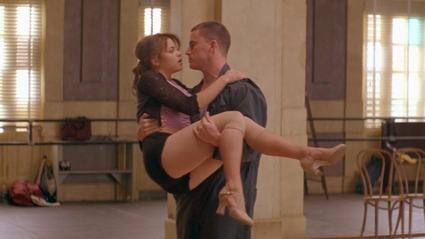 Channing Tatum as Tyler holds Jenna Dewan as Tatum in his arms in the middle of a dance studio