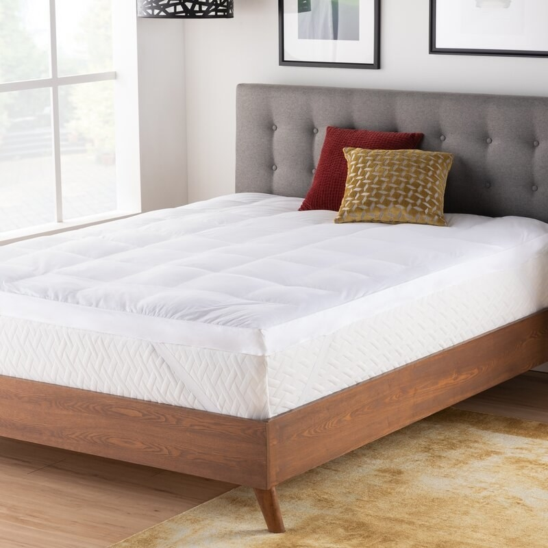 Mattress topper on bed frame