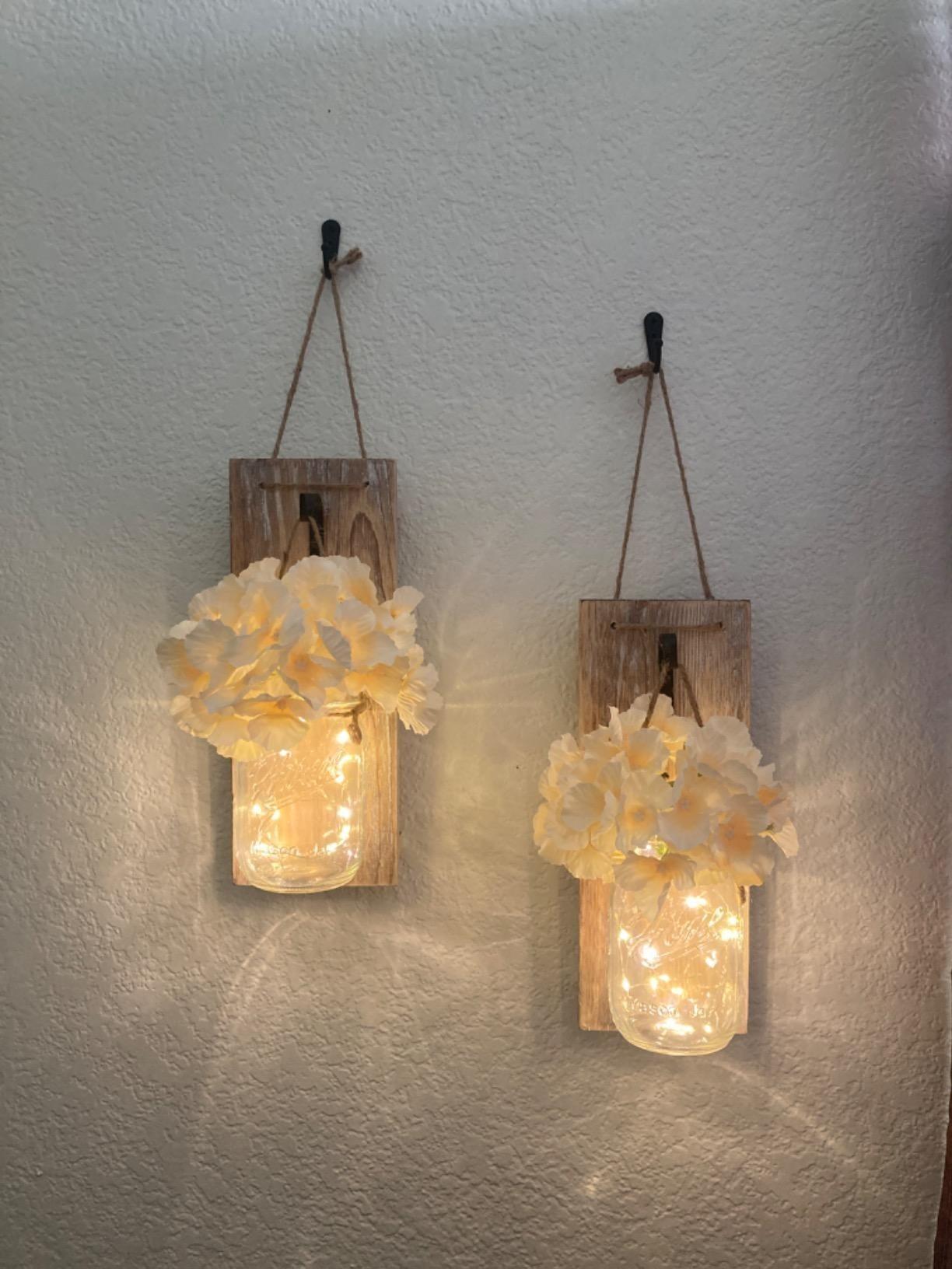 Mason jar lights hanging on wall