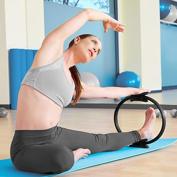 Woman stretching with the Pilates ring.