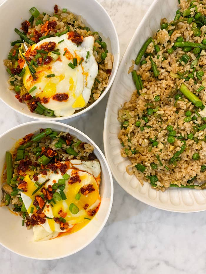 Spring vegetable fried rice topped with an egg.