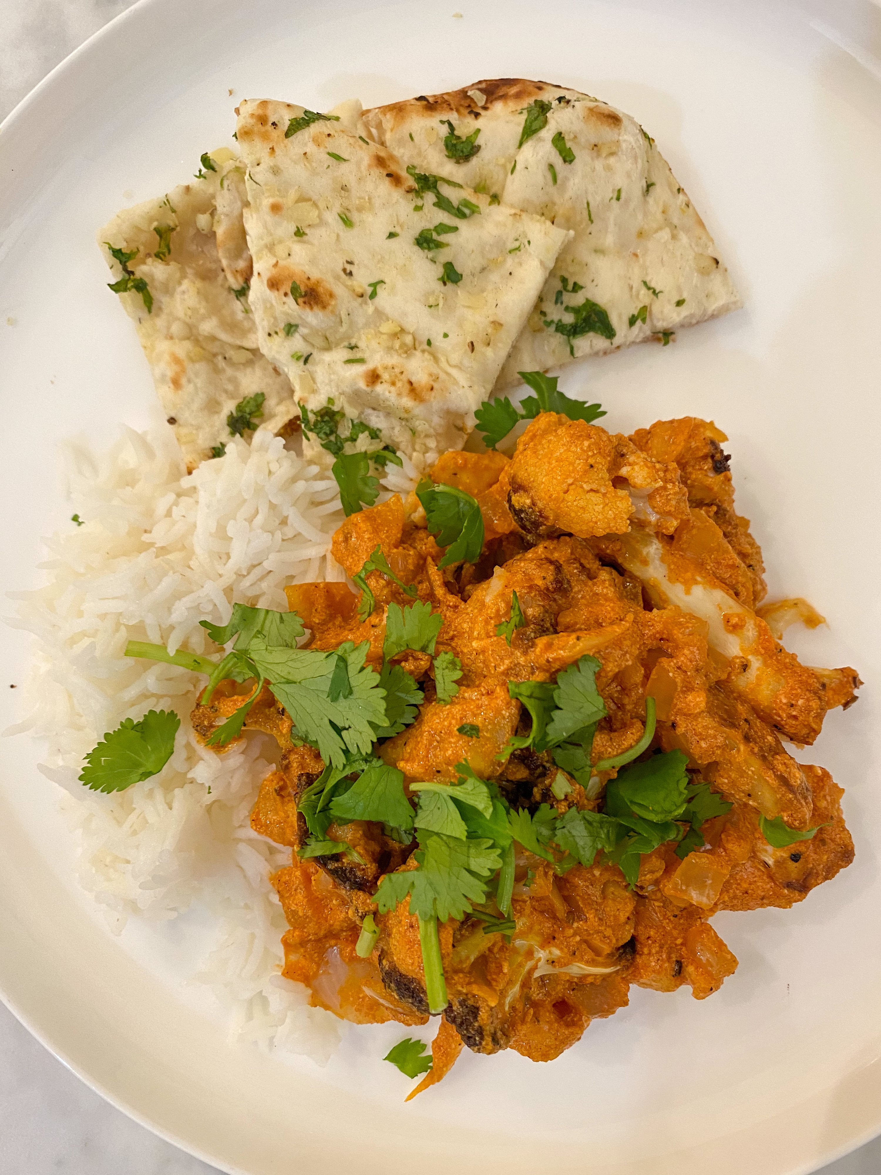Butter cauliflower with rice and naan.