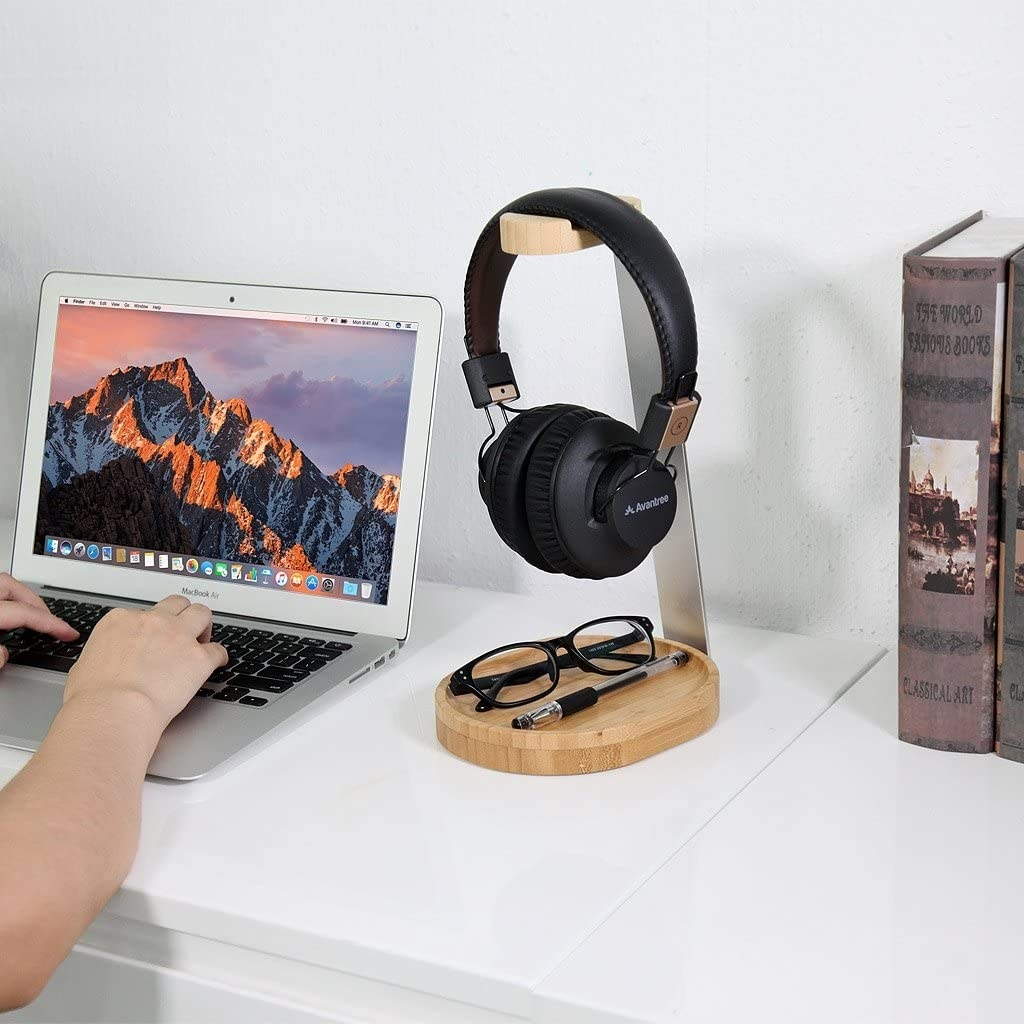 wooden and metal headphone stand with a tray at the bottom