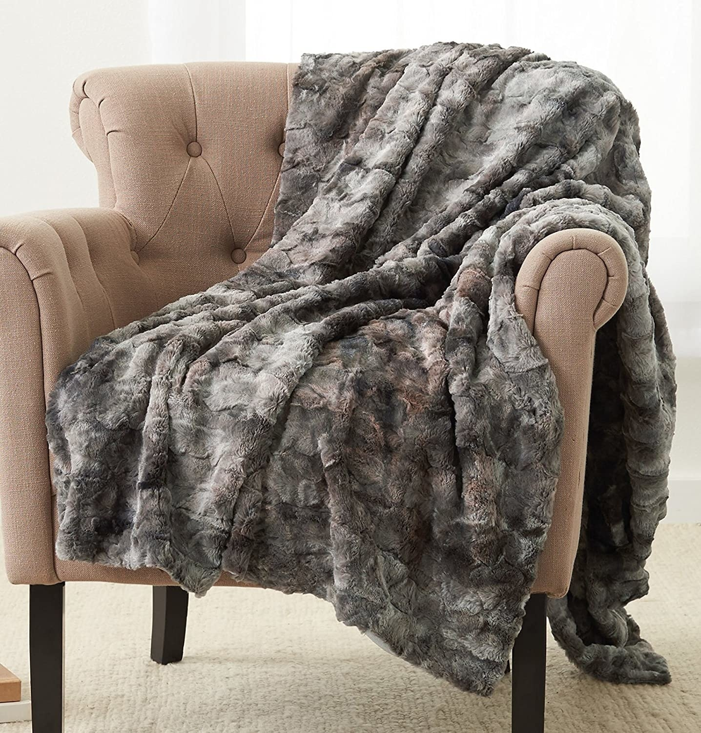 gray faux fur blanket thrown over a side chair