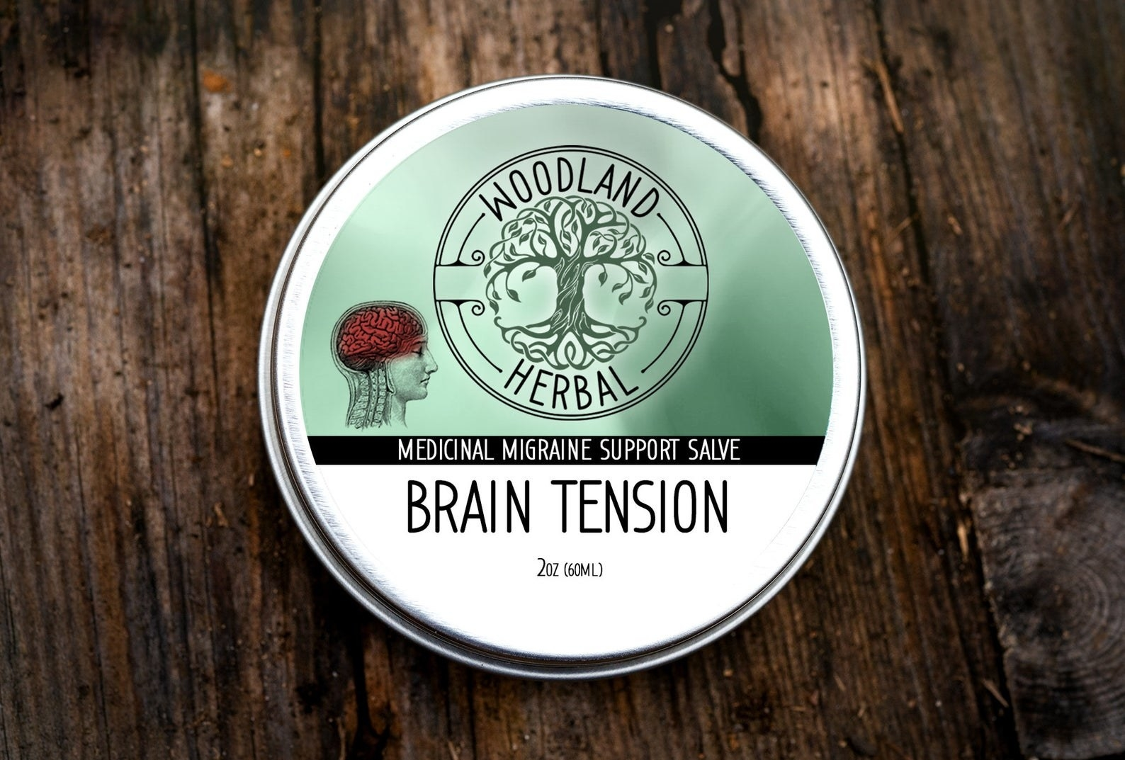 Brain tension salve in a metal container