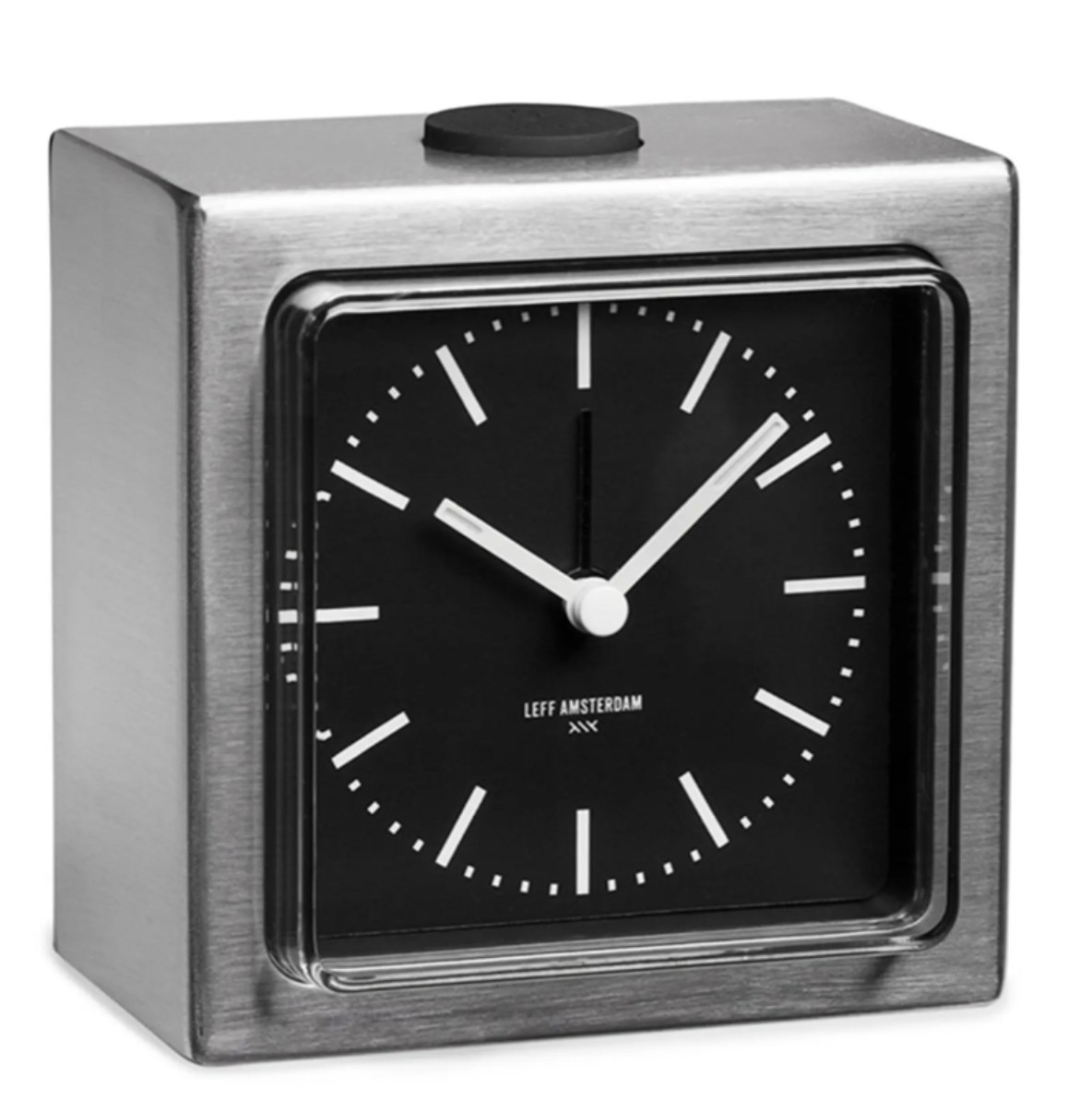 a silver block alarm clock with white arms and a black clock face