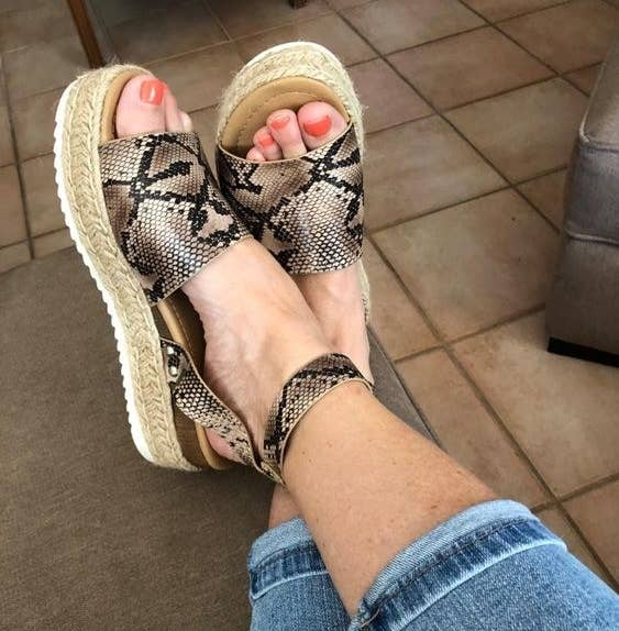 Reviewer wearing the espadrilles in leopard print