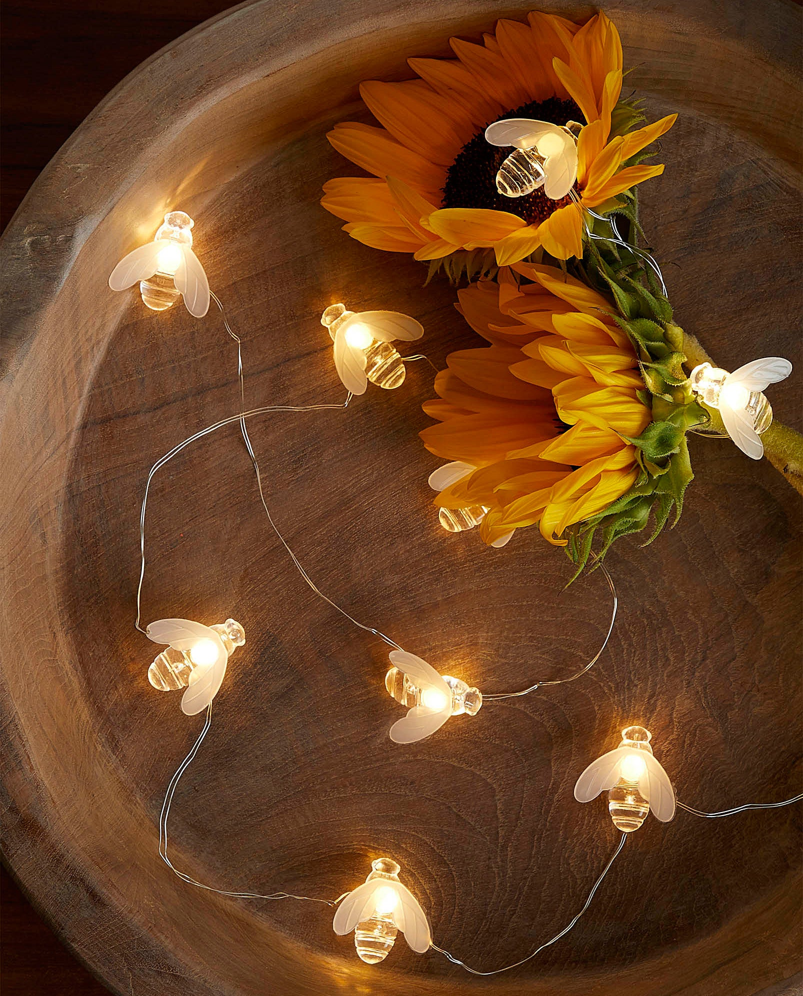 A string of bee-shaped fairy lights
