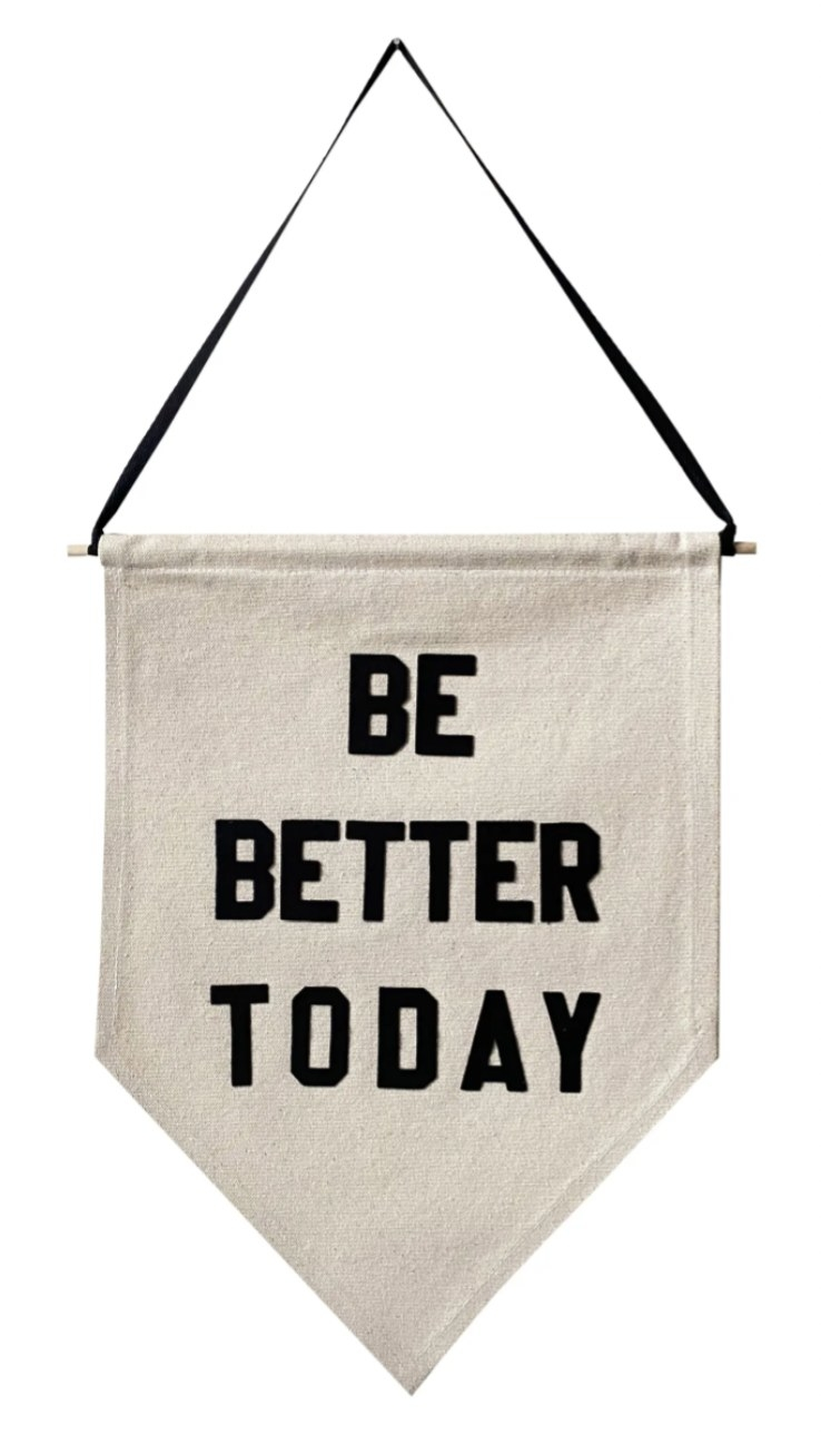 """a linen pennant that reads """"be better today"""" in black text with a black hanging ribbon"""