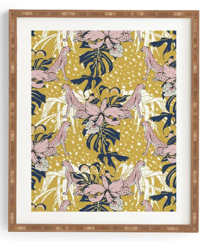 a wall art print with lions, flowers, and plants