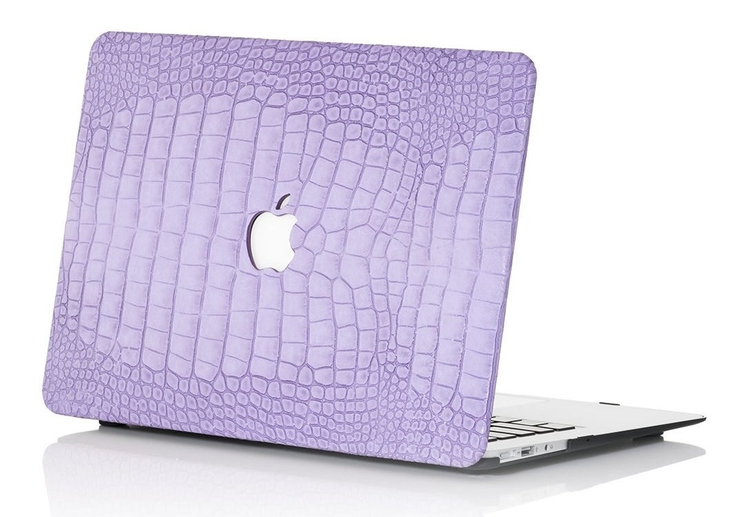 Apple laptop with a lavender cover in a faux-crocodile finish