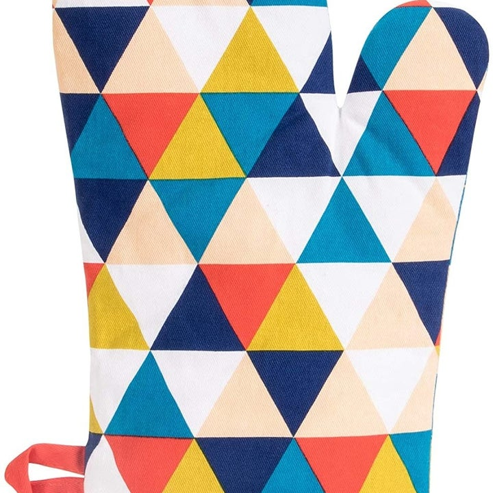 The backside of the oven mitt, which is a multicolored triangle print