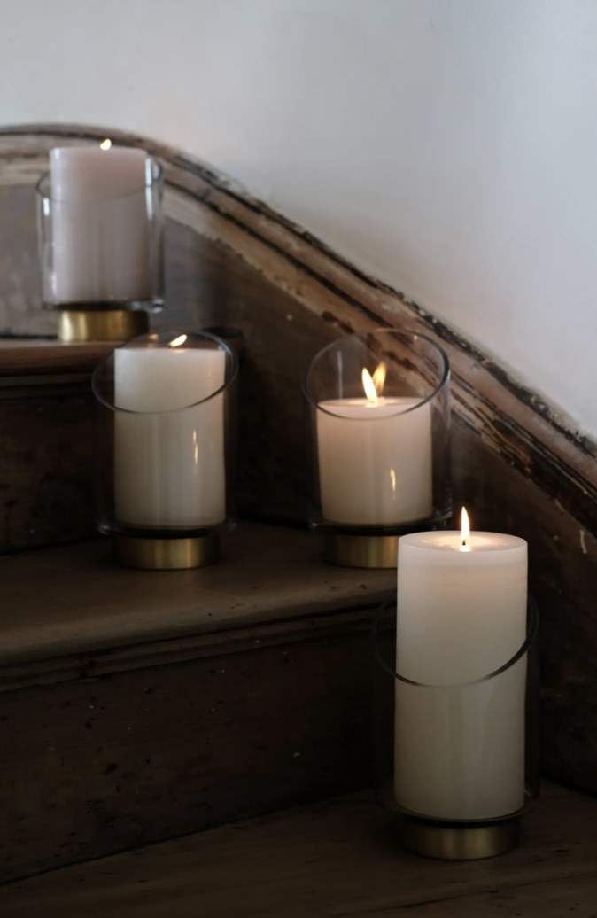 four candle holders with gold bases