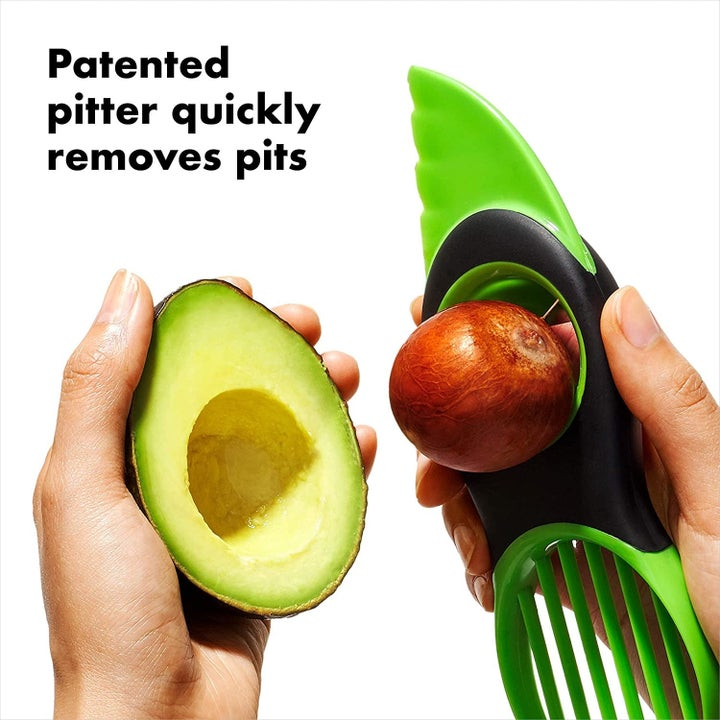 The tool with an avocado pit in the pitter