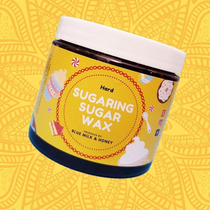 container of hard sugaring sugar wax