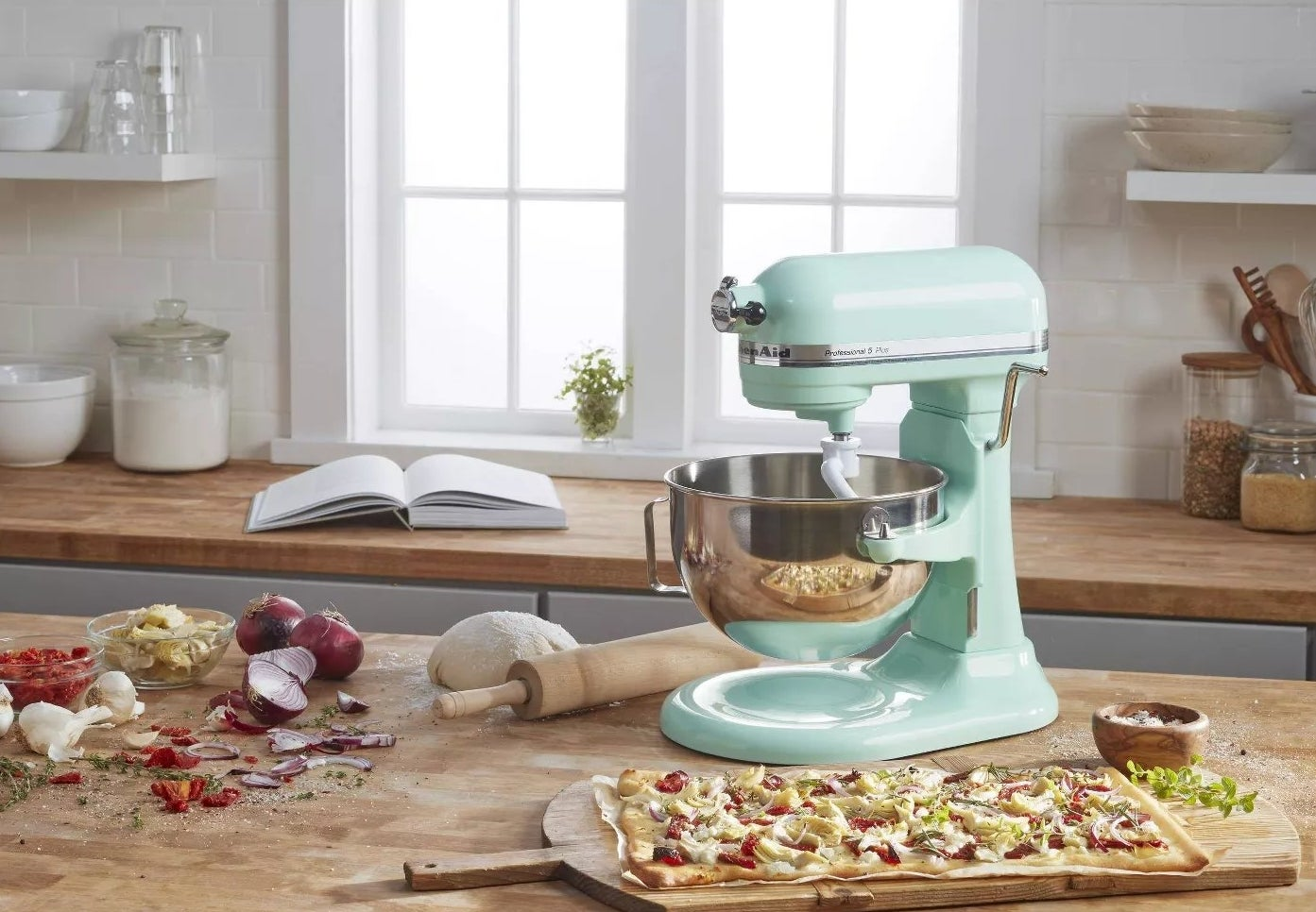 The mixer on a kitchen counter making pizza dough