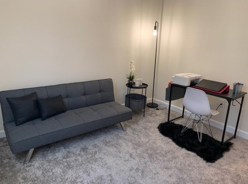 A grey futon in a reviewer's home