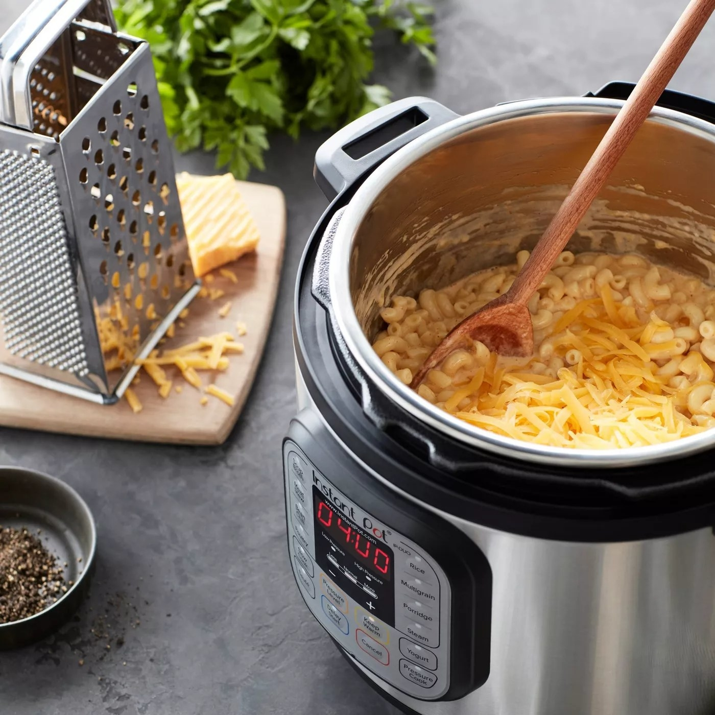 The pressure cooker on a kitchen counter making mac and cheese