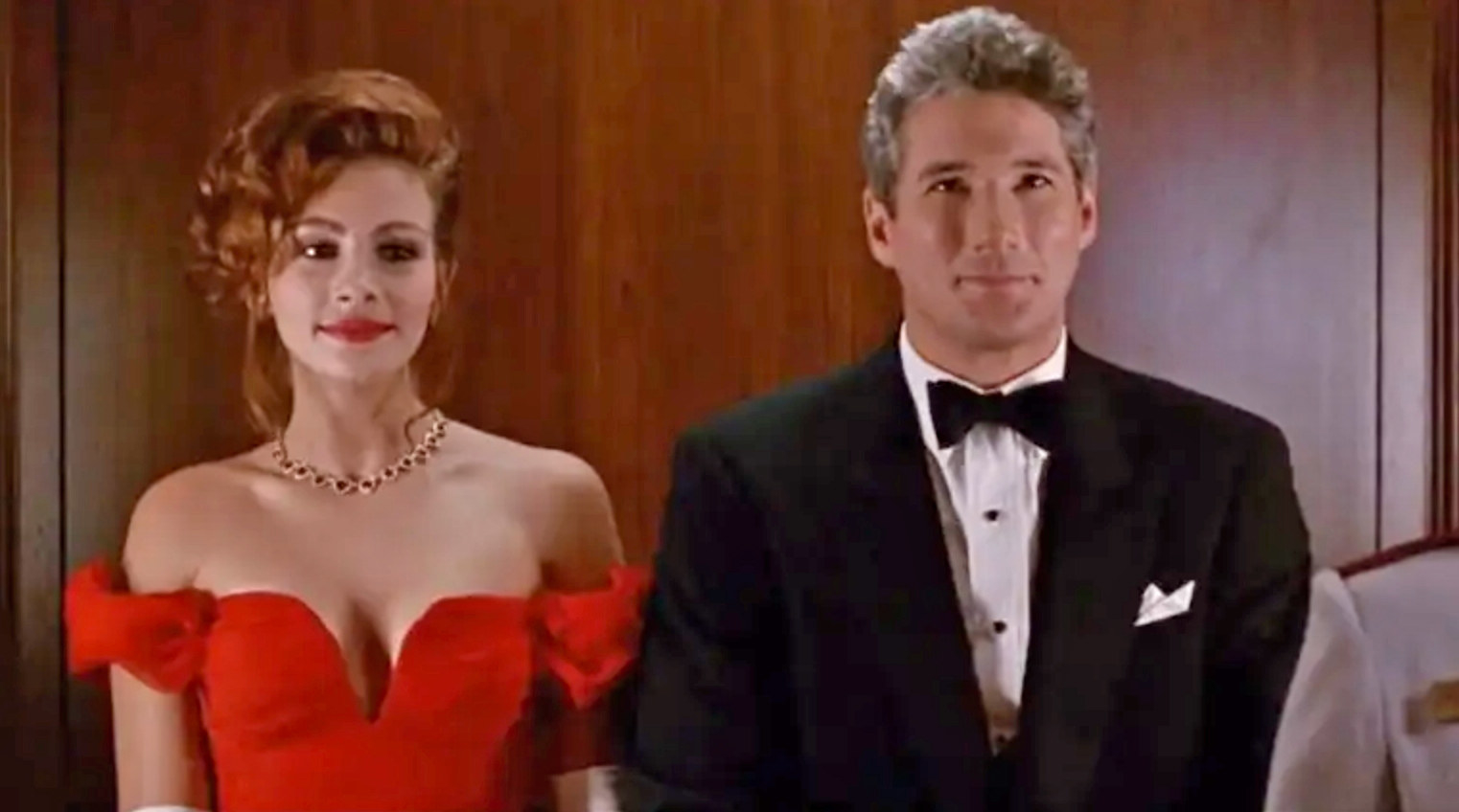 Julia Roberts and Richard Gere stand next to each other wearing fancy clothes as Vivian and Edward