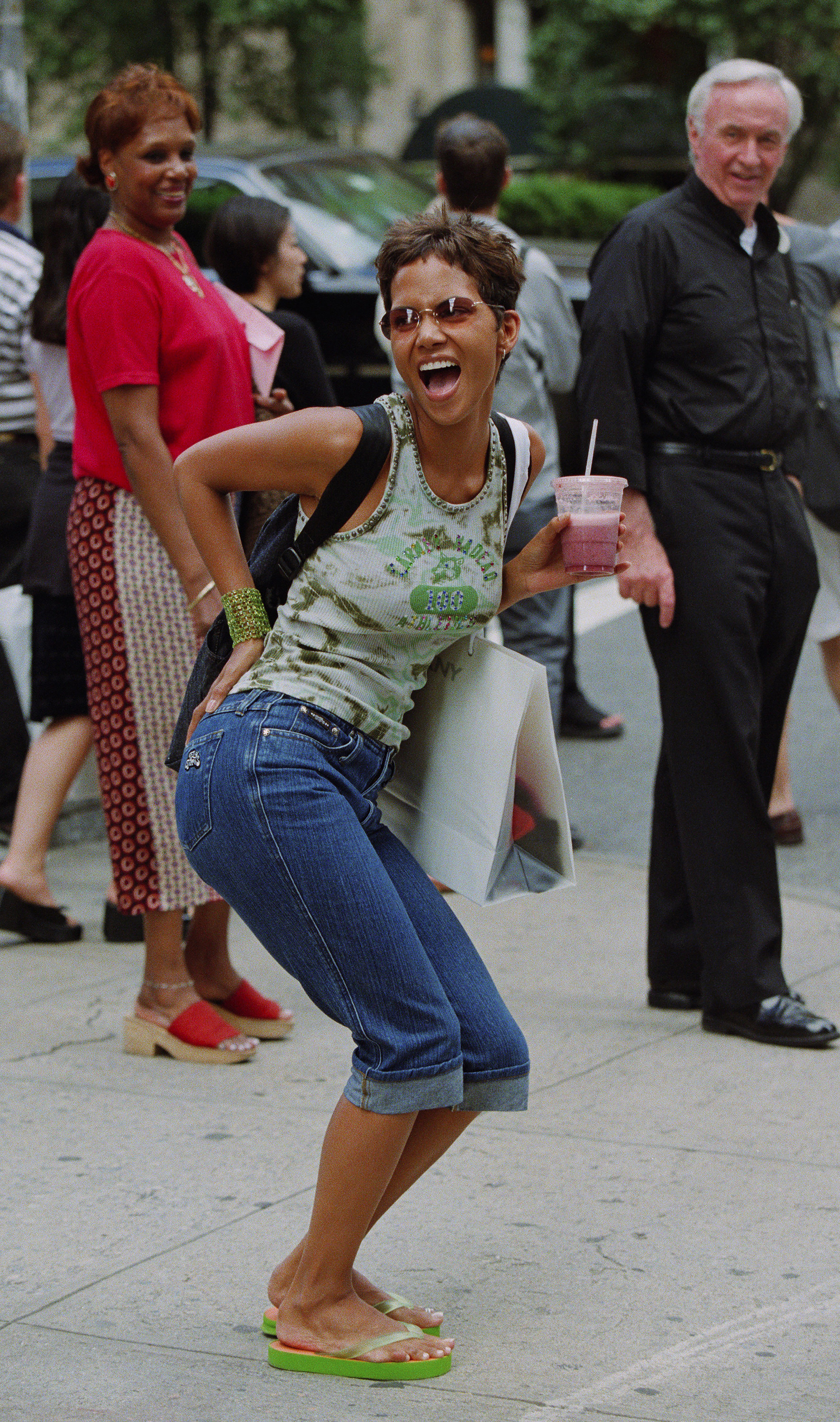 Halle Berry in flip-flops and jeans poses for the camera
