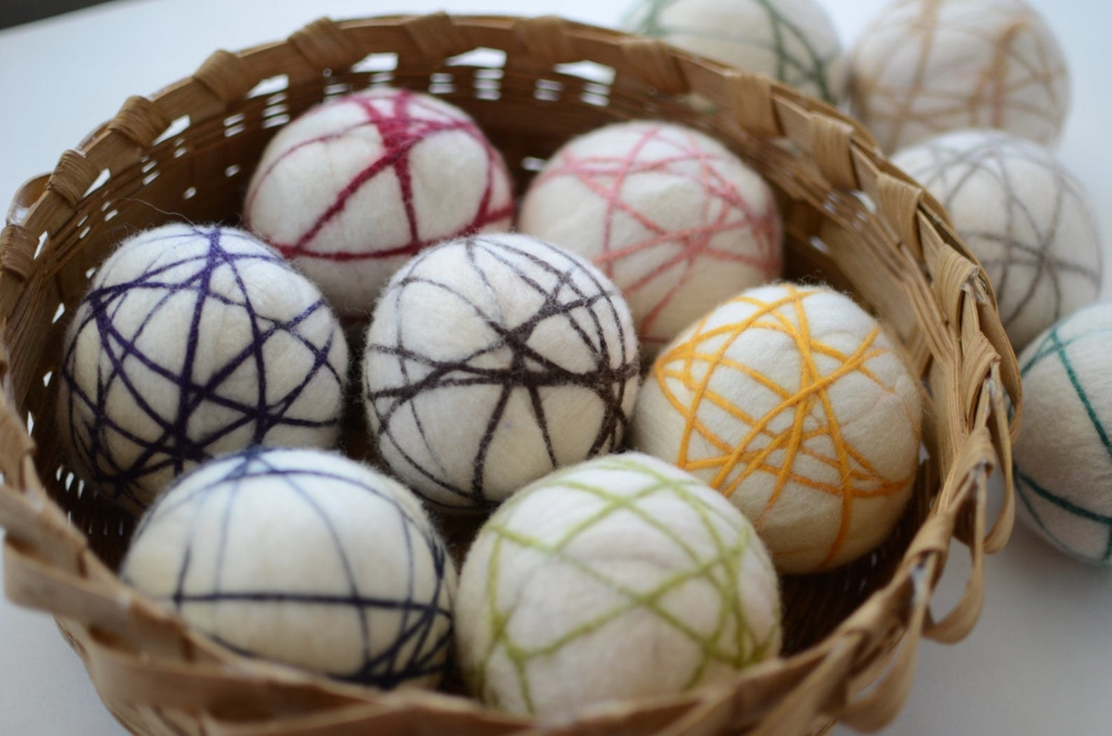 The dryer balls with different colors of thread