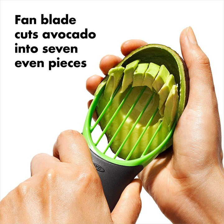 Hand slicing the avocado into seven neat pieces using the tool