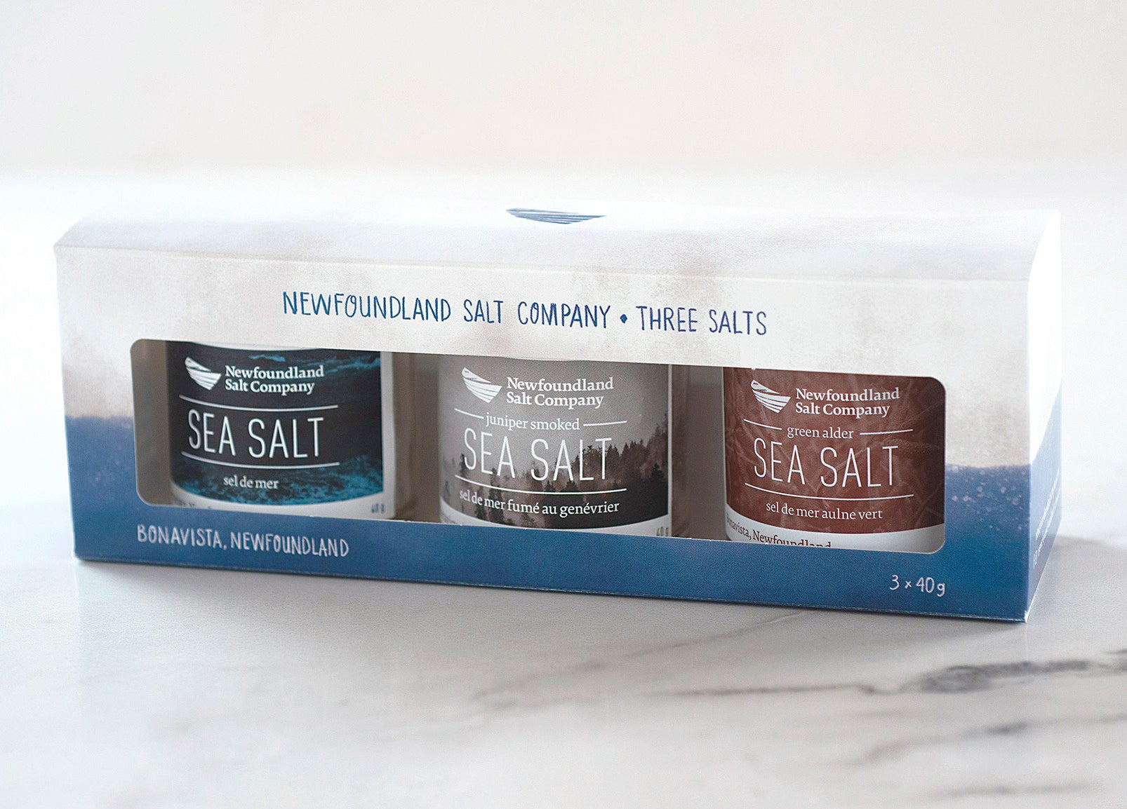 A trio of flavoured sea salts on a marble countertop