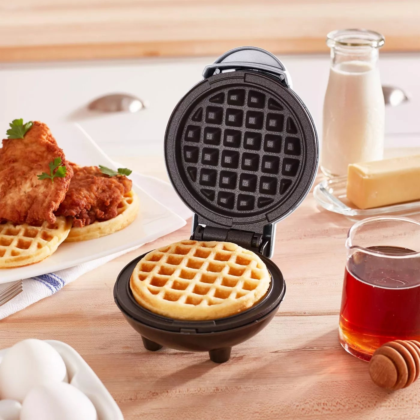 The open waffle maker with a 4'' waffle inside
