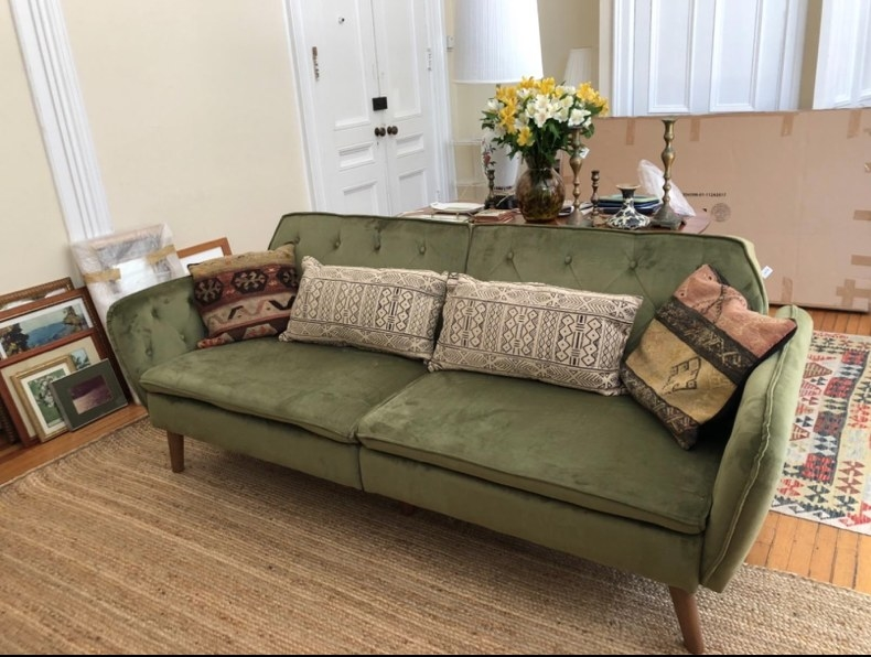 A green futon in a reviewer's home