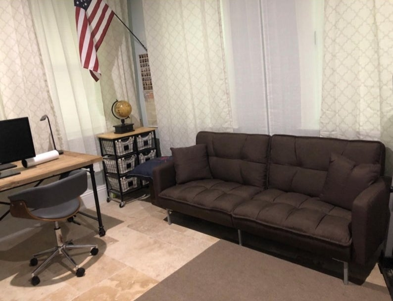 A brown futon in a reviewer's home