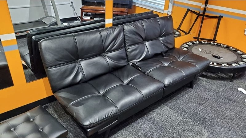A faux-leather futon in a reviewer's home
