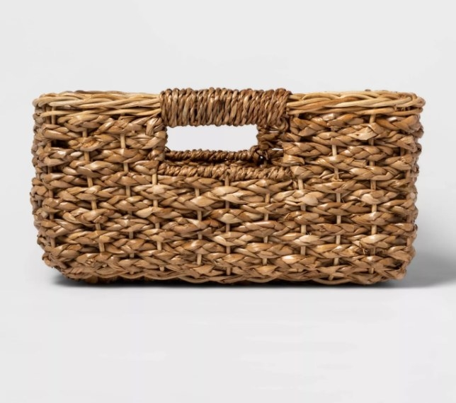 A rectangular storage basket that fits nicely on kitchen countertops, shelves, or islands