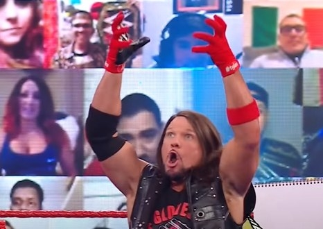 AJ Styles raising his arms during a game of charades
