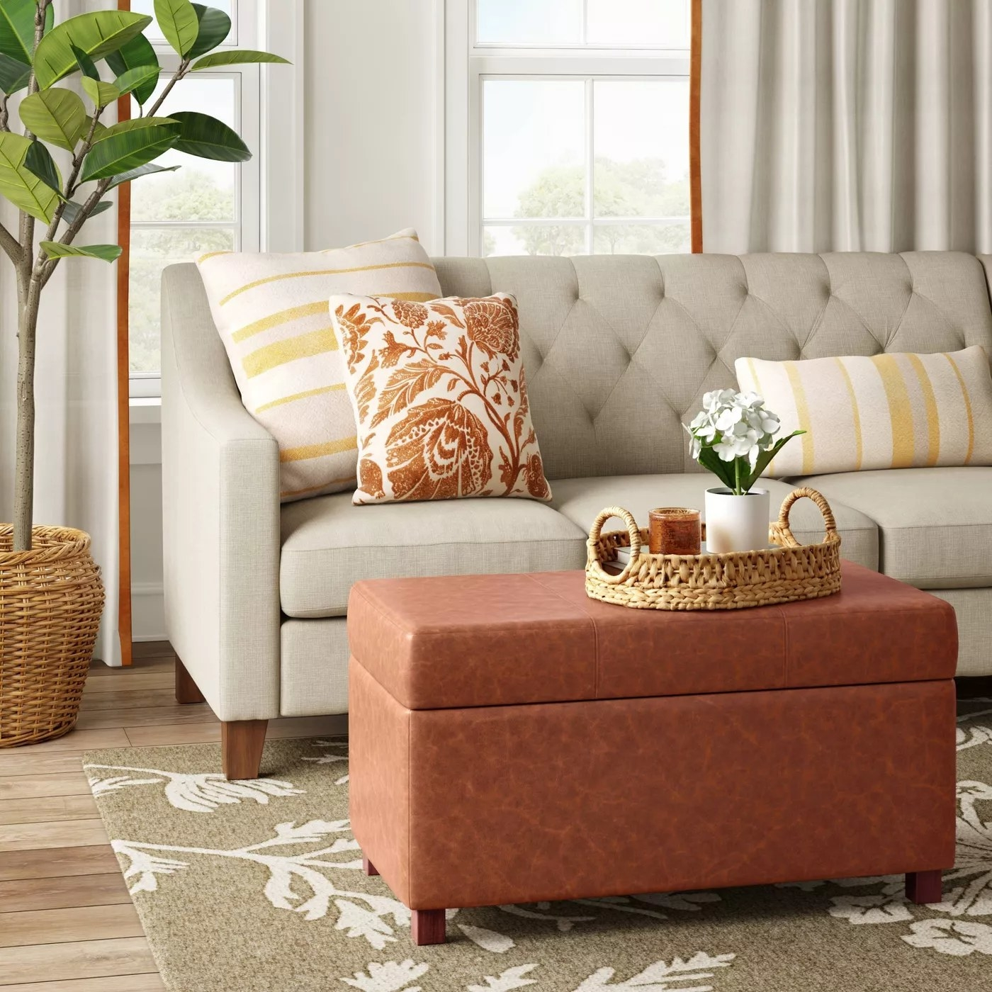 The storage ottoman functioning as a coffee table in a living room