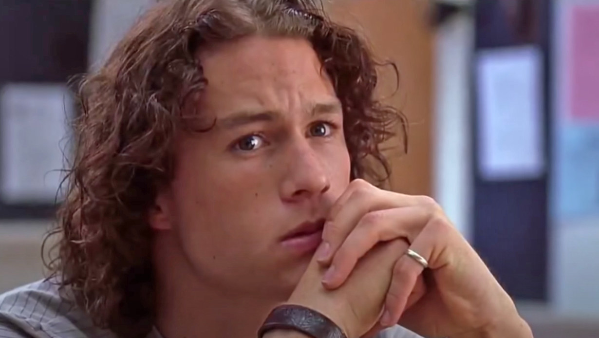 Heath Ledger clasps his hands in front of his mouth as tears form in his eyes as Patrick