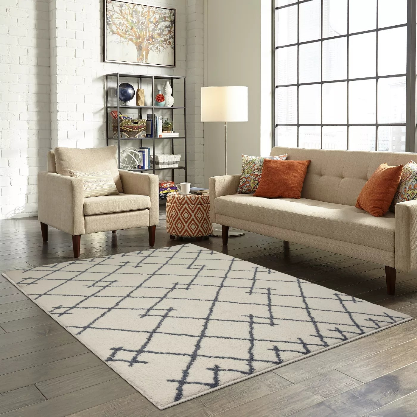 The white tufted rug with a grey geometric pattern in a living room
