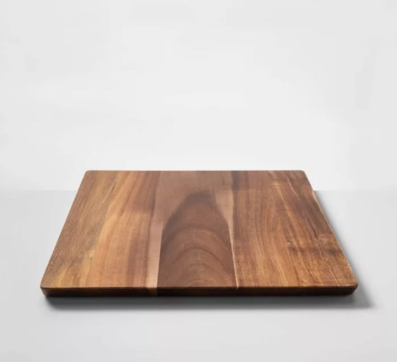 A 13''x18''wooden cutting board that helps with meal prep and serving guests at dinner parties