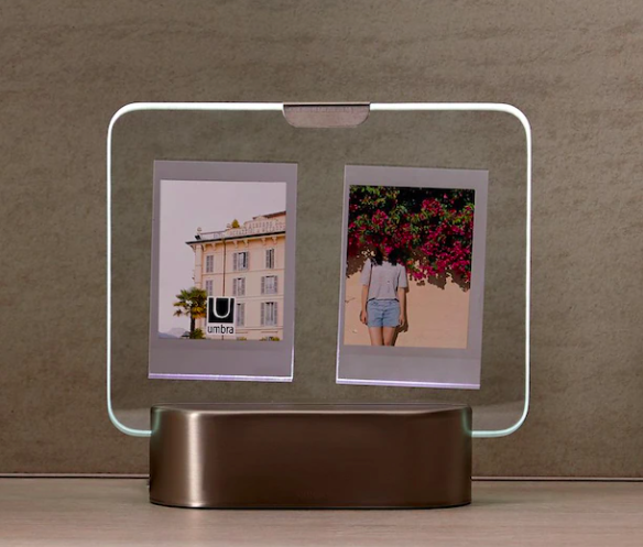 A light-up picture frame holding two photos in the glass