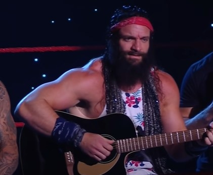 Elias playing his guitar