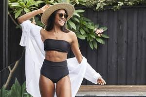 A model wearing the ModiBodi period-friendly bikini bottoms