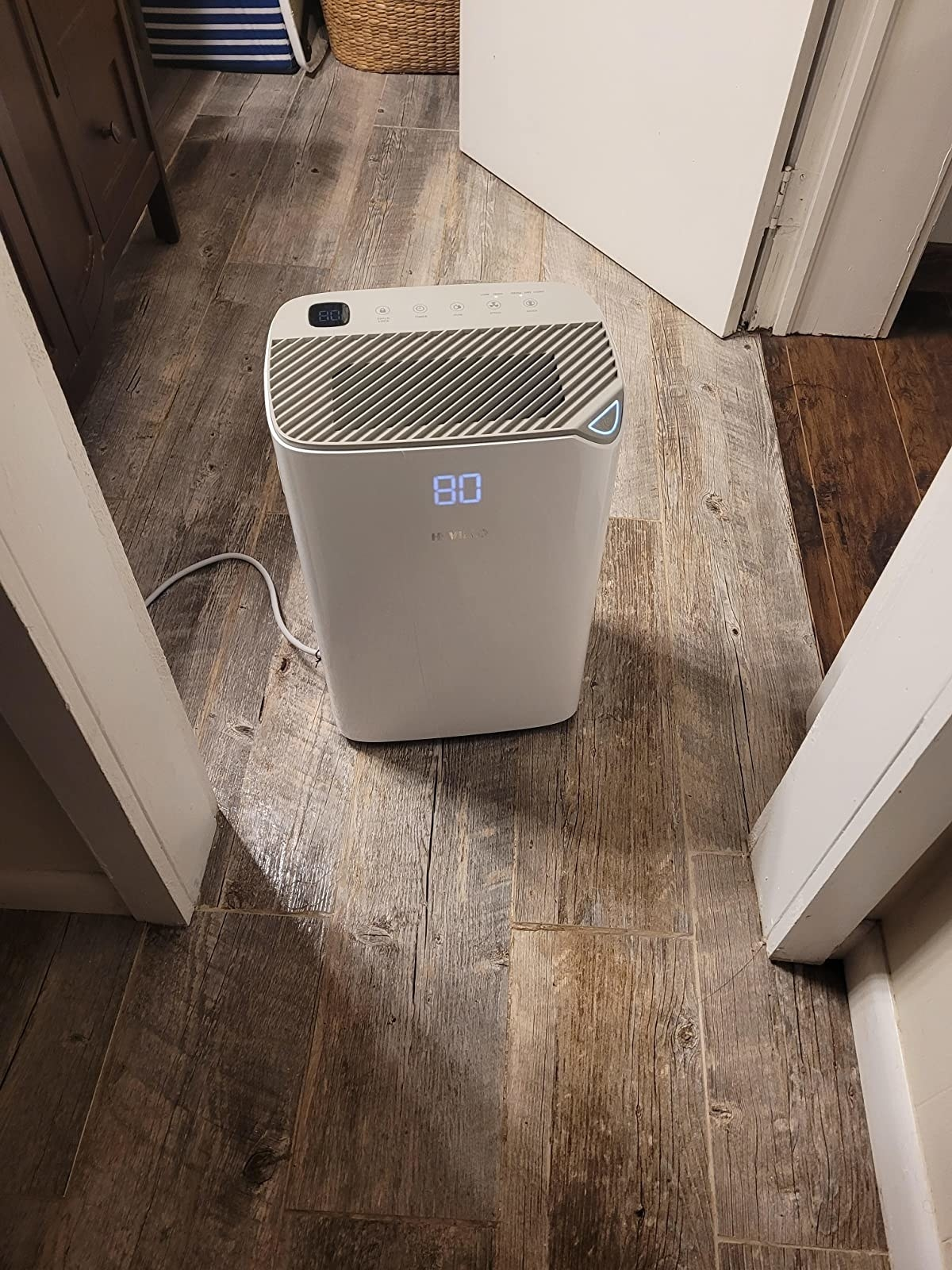 reviewer image of the hevillo dehumidifier turned to 80