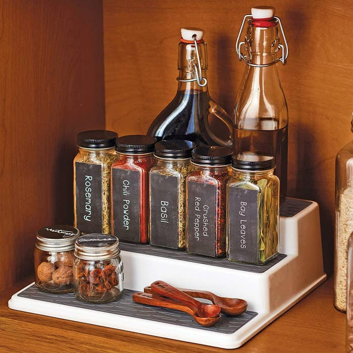 Various bottles and spices placed on three-tiered stand